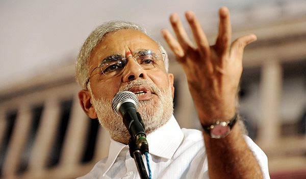 Feel proud to ask from people rather than looting them: Modi