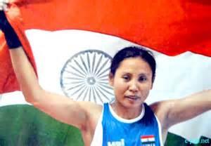 Boxer Sarita Devi accepts her Asian Games bronze medal